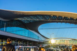 Terminal D of Sheremetyevo airport in the sunset.