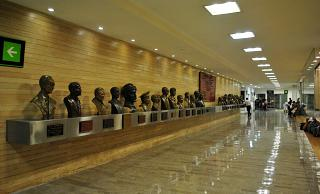 Alley with busts of famous pilots in the terminal T1 of the airport of Mexico city Benito Juarez