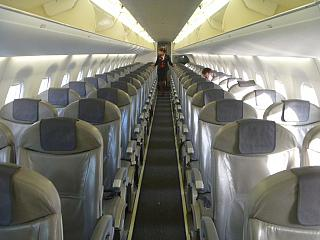 The passenger cabin of the Embraer 195 airline Belavia