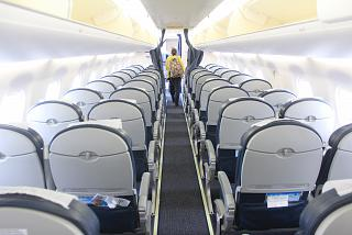 The cabin of the aircraft Embraer-190 Ukraine International airlines