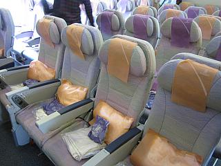 The economy class cabin of a Boeing 777-300 Emirates airline