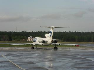 "The plane Tu-154 of airline ""UTair"" at the airport of Surgut"