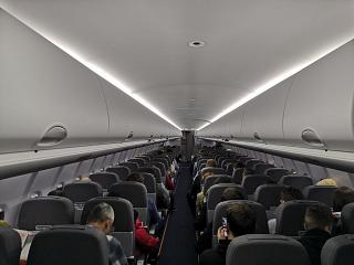The passenger cabin of the aircraft Sukhoi Superjet-100 of airline Azimut