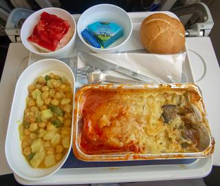 A hot meal in economy class on the flight from Moscow to Frankfurt Lufthansa