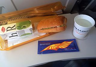 "Of a lunchbox with a sandwich and juice on the flight from Moscow to Rostov airline ""Donavia"""