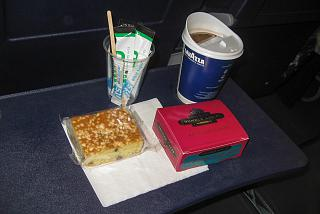 Coffee and a muffin a paid meal on a flight of the airline Ryaniar