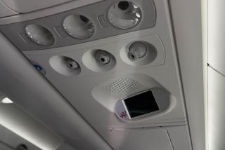 The panel above the passenger seat in the aircraft, Bombardier CS100