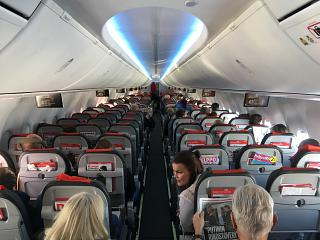 The passenger cabin of the Boeing 737 max 8 airline Norwegian