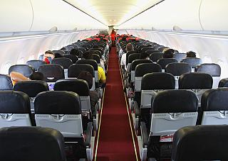 The cabin of the aircraft Airbus A320 Air Asia
