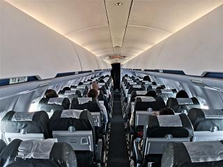 The passenger cabin of the Bombardier CRJ100 aircraft of the airline Rusline