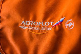 Embroidered logo of Aeroflot on the headrest