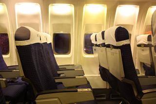 "The cabin of the aircraft Boeing-737-200 of airline ""Aurora"""