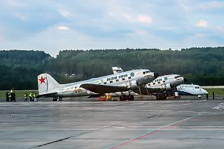 Douglas DC-3 at the airport of Krasnoyarsk during the flight on the highway