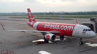 The aircraft of the airline Thai AirAsia at don Mueang airport (Bangkok, Thailand)