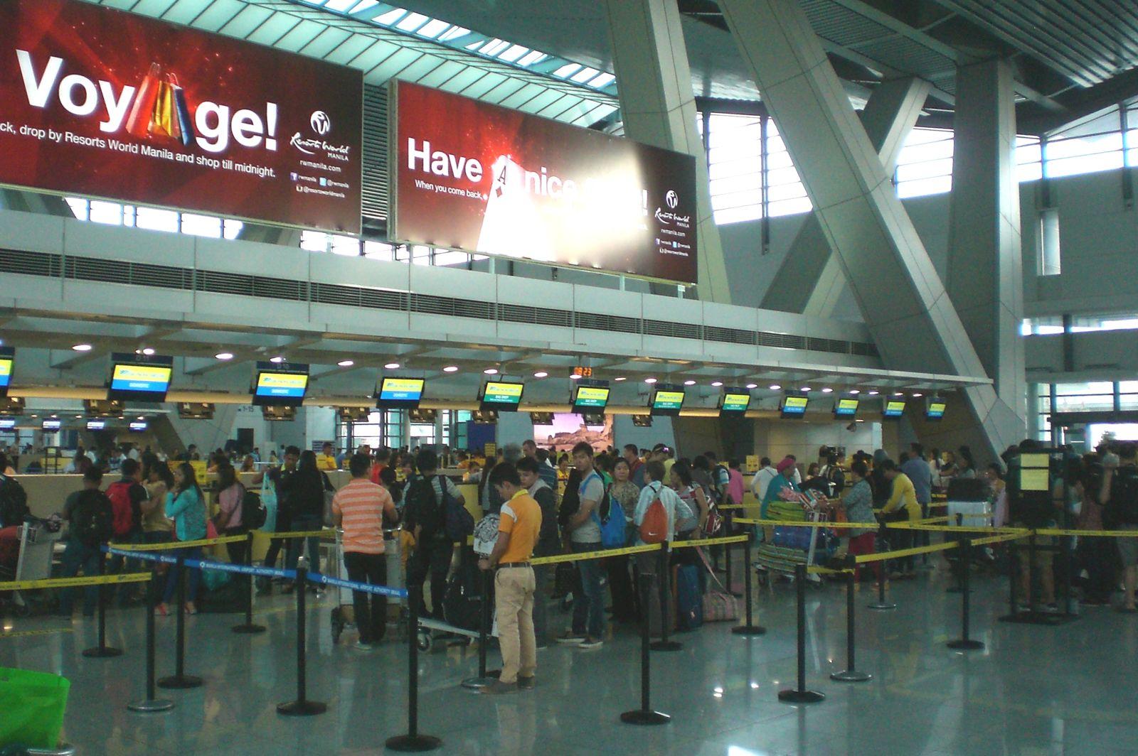 Регистрация на вылетающие рейсы в терминале 3 аэропорта Манилы