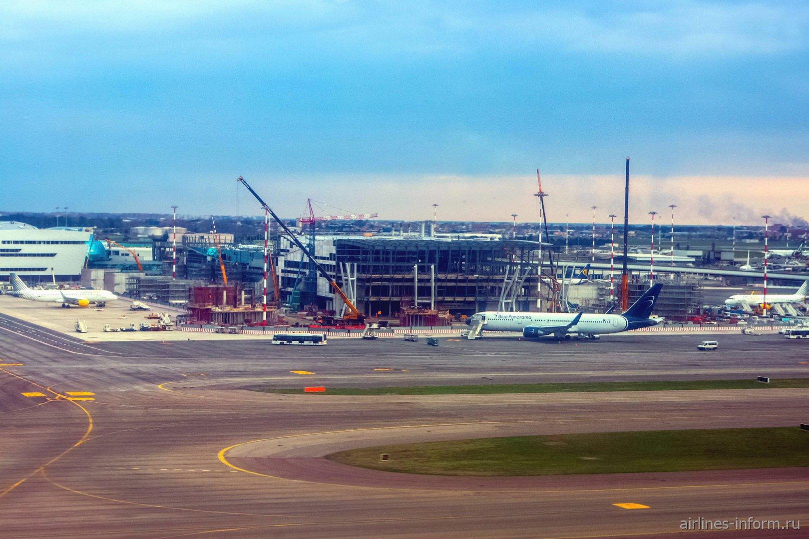 Строящийся пирс F терминала 1 аэропорта Рим Фьюмичино
