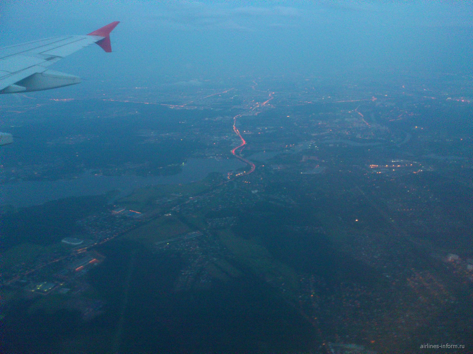 Вид из иллюминатора на Москву