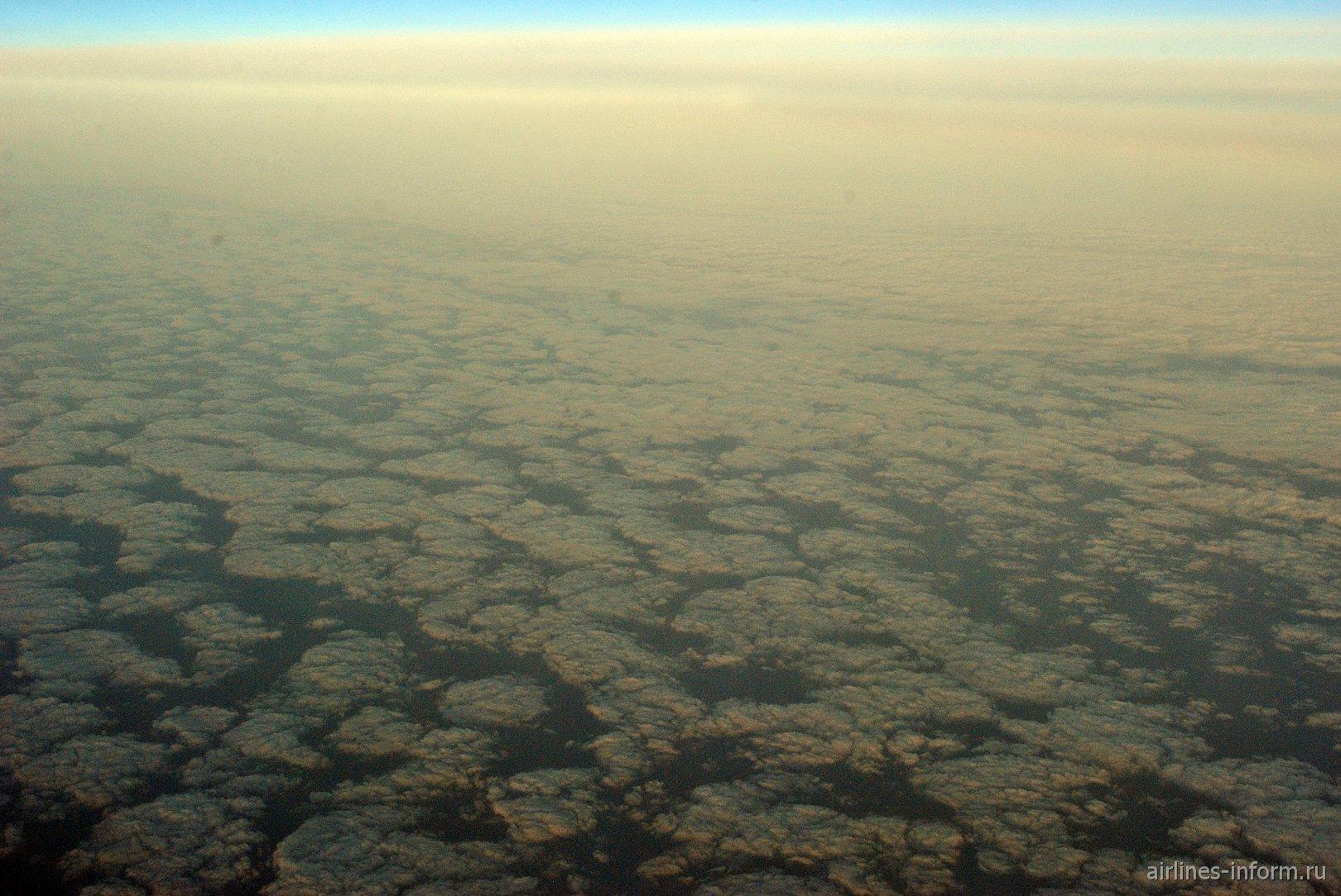 Облака на рассвете над Северным морем