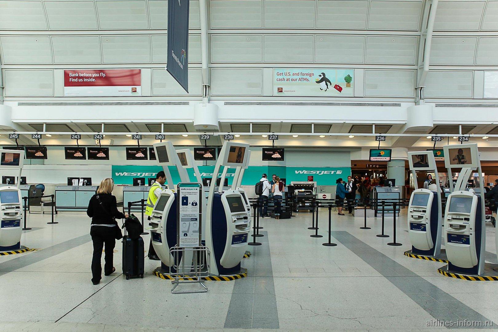 Зона регистрации авиакомпании WestJet в терминале 3 аэропорта Торонто Пирсон