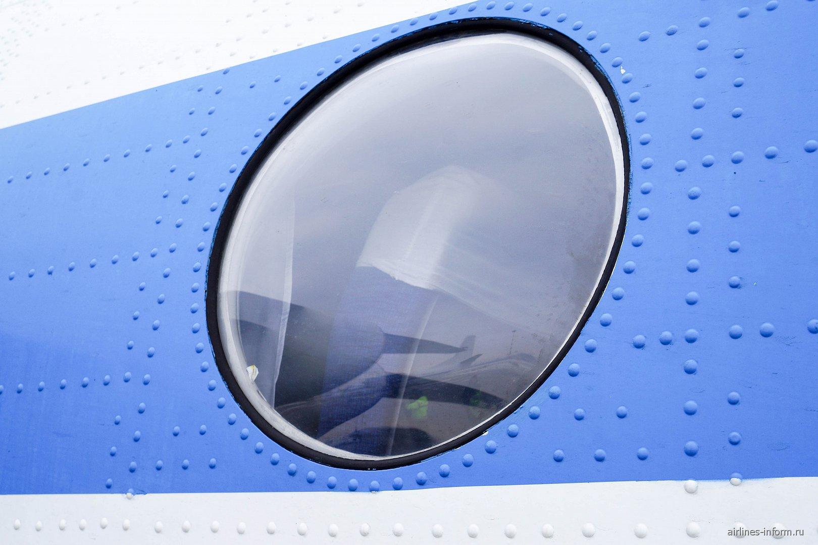 Иллюминатор в самолете Ан-24 авиакомпании