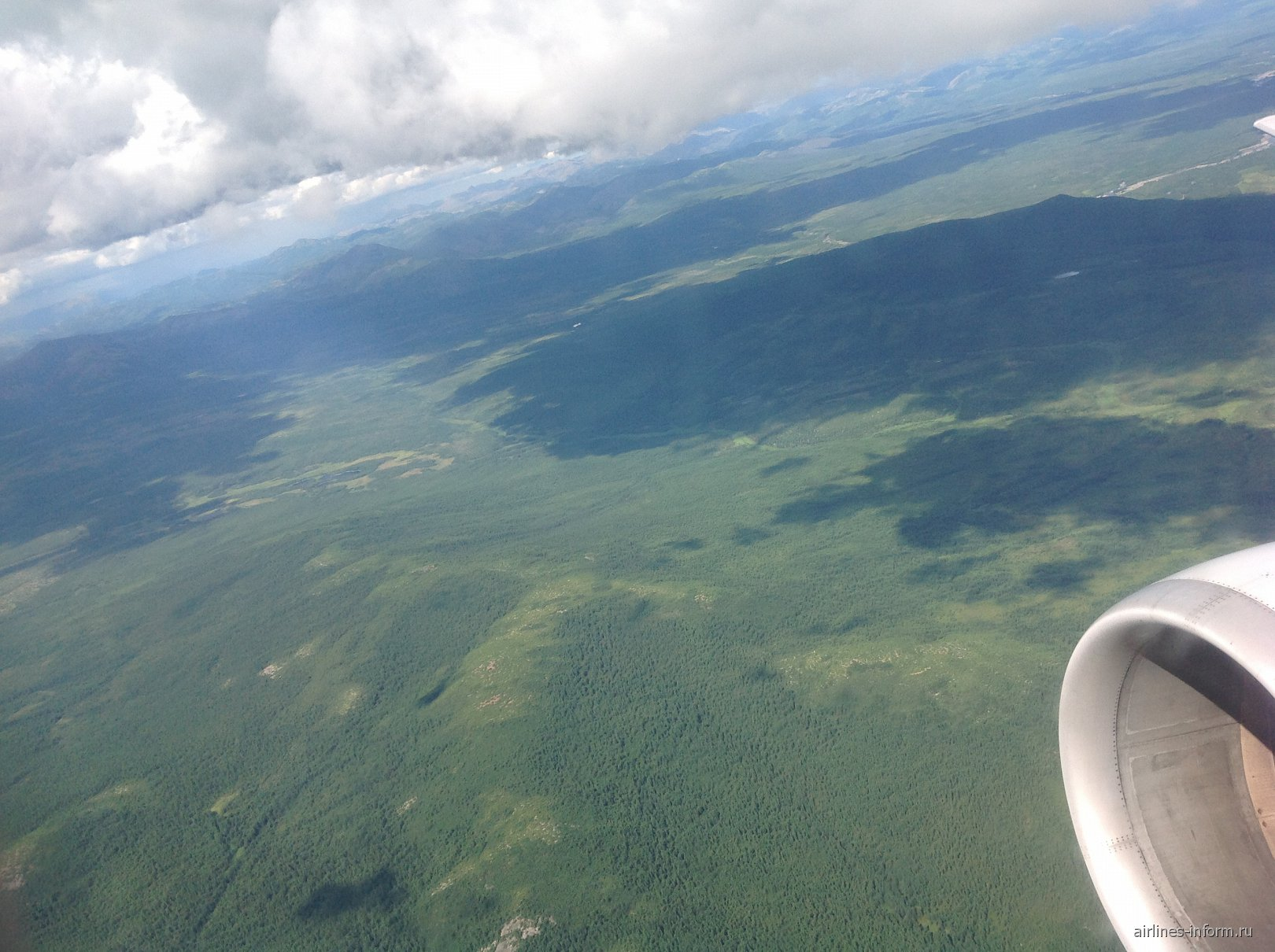 Вид из иллюминатора при взлете из Магадана
