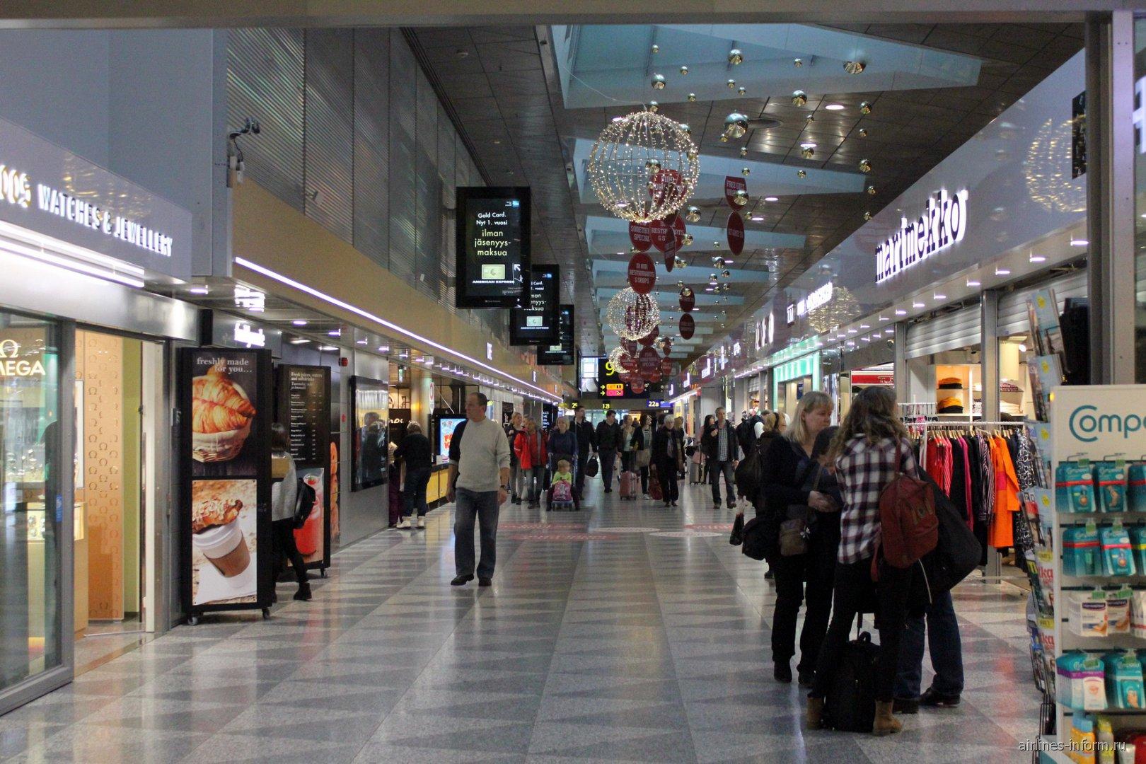 Галерея магазинов в терминале 2 аэропорта Хельсинки Вантаа