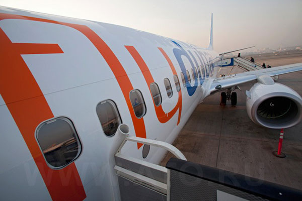 Посадка в самолет в аэропорту Дубая