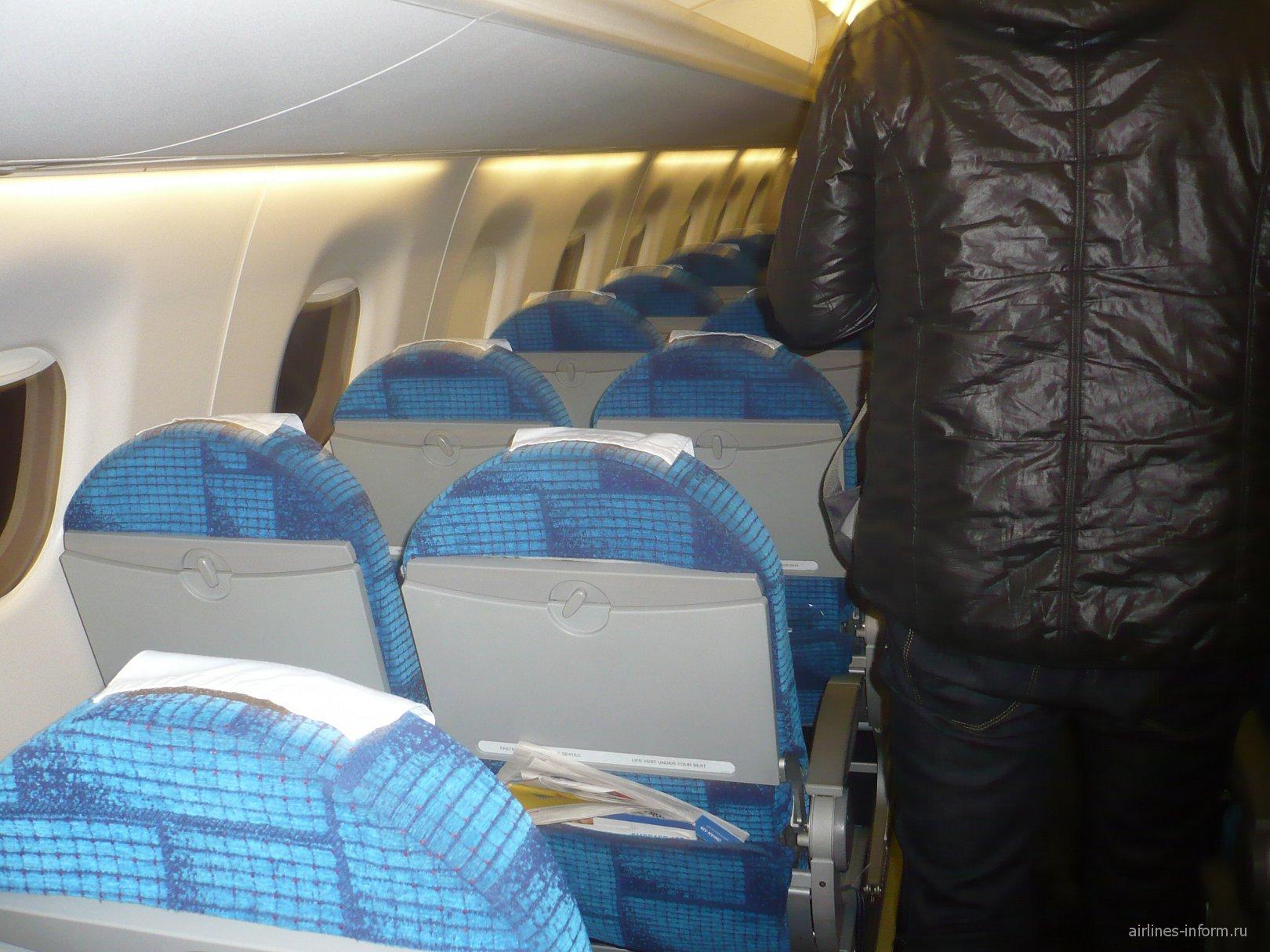 Салон самолета Bombardier CRJ900 авиакомпании Estonian Air