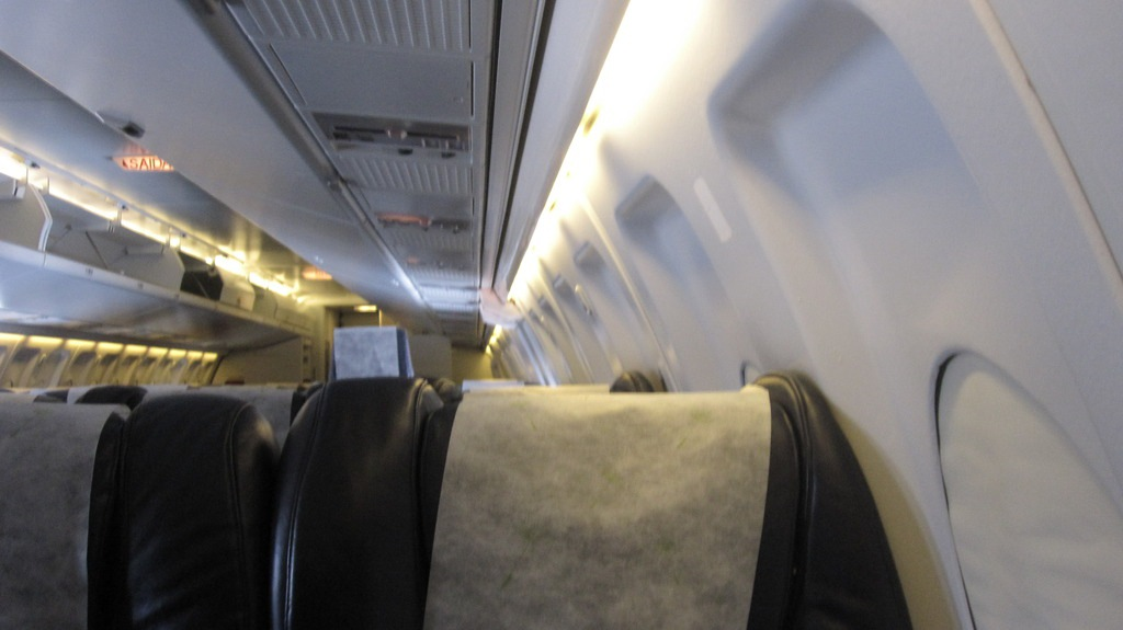 Passenger cabin of Fokker 100 of Portugalia Airlines