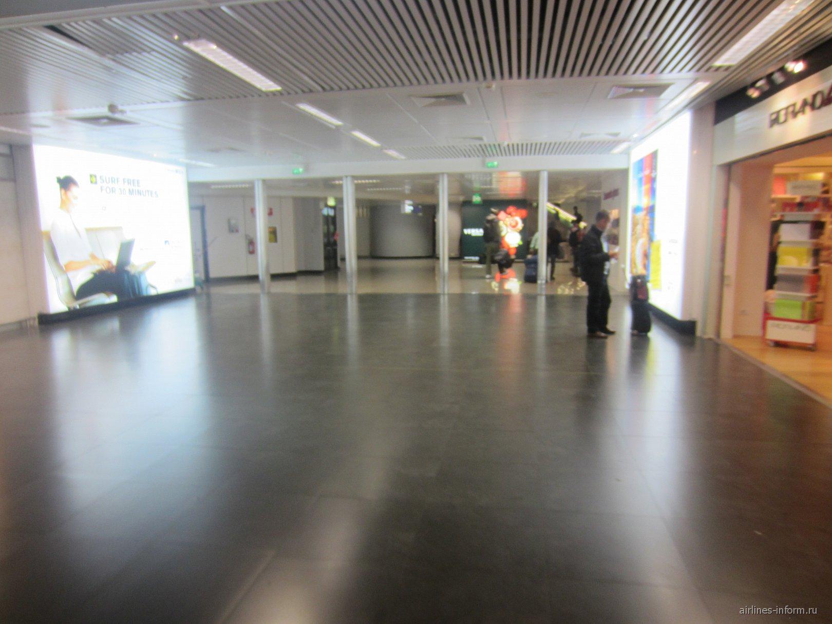 Терминал 1 аэропорта Фьюмичино в Риме