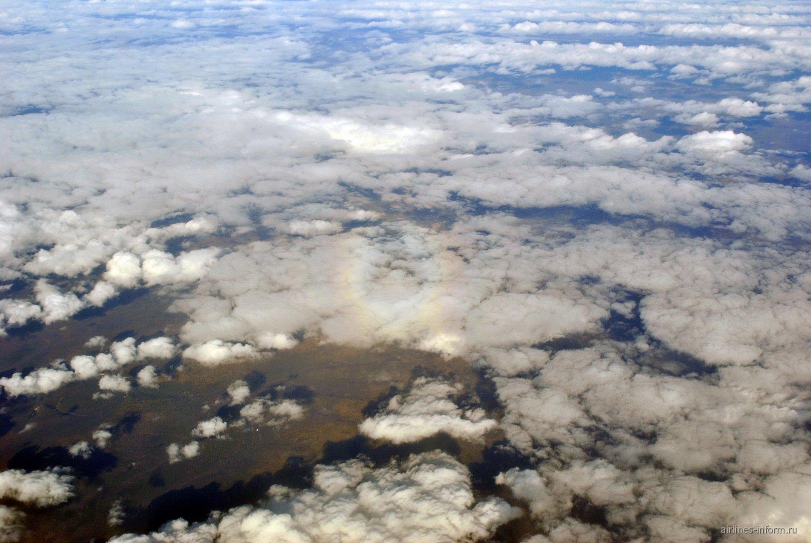 """""""Глория"""" на облаках над Восточной Сибирью"""