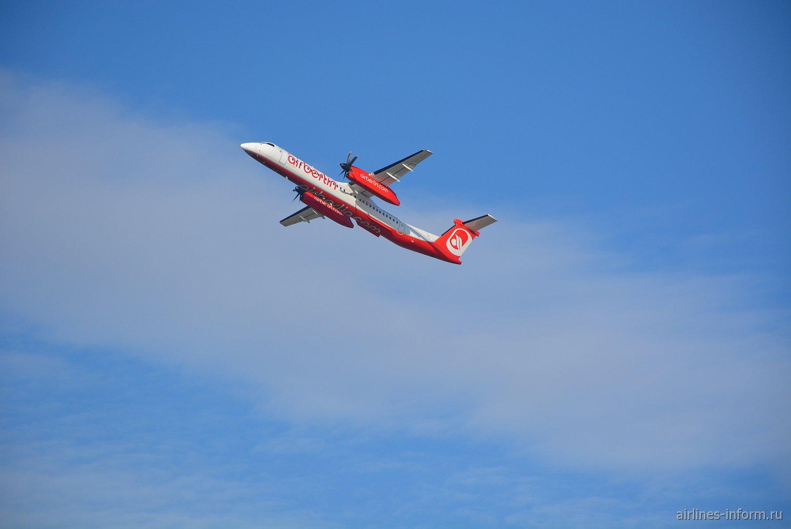 Взлет Bombardier Dash 8 Q400 из аэропорта Дюссельдорфа