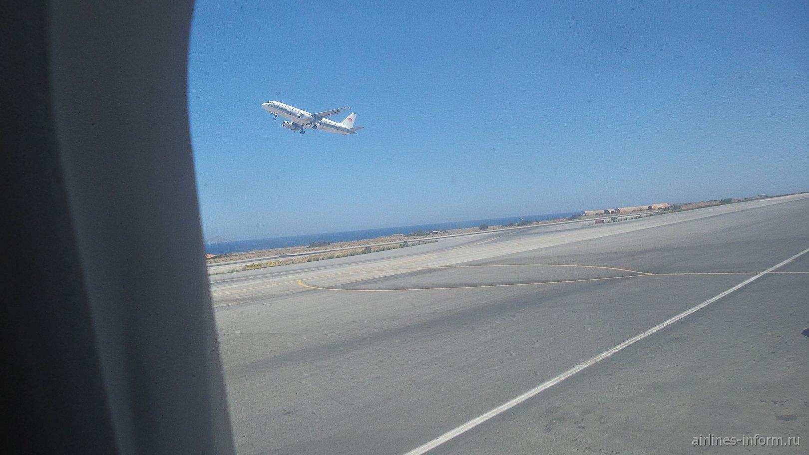 Взлетает А320 Meridiana.