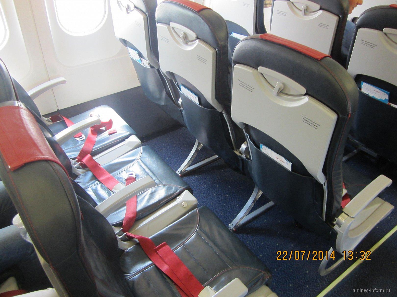 Пассажирские кресла в самолете Airbus A321 авиакомпании Windrose