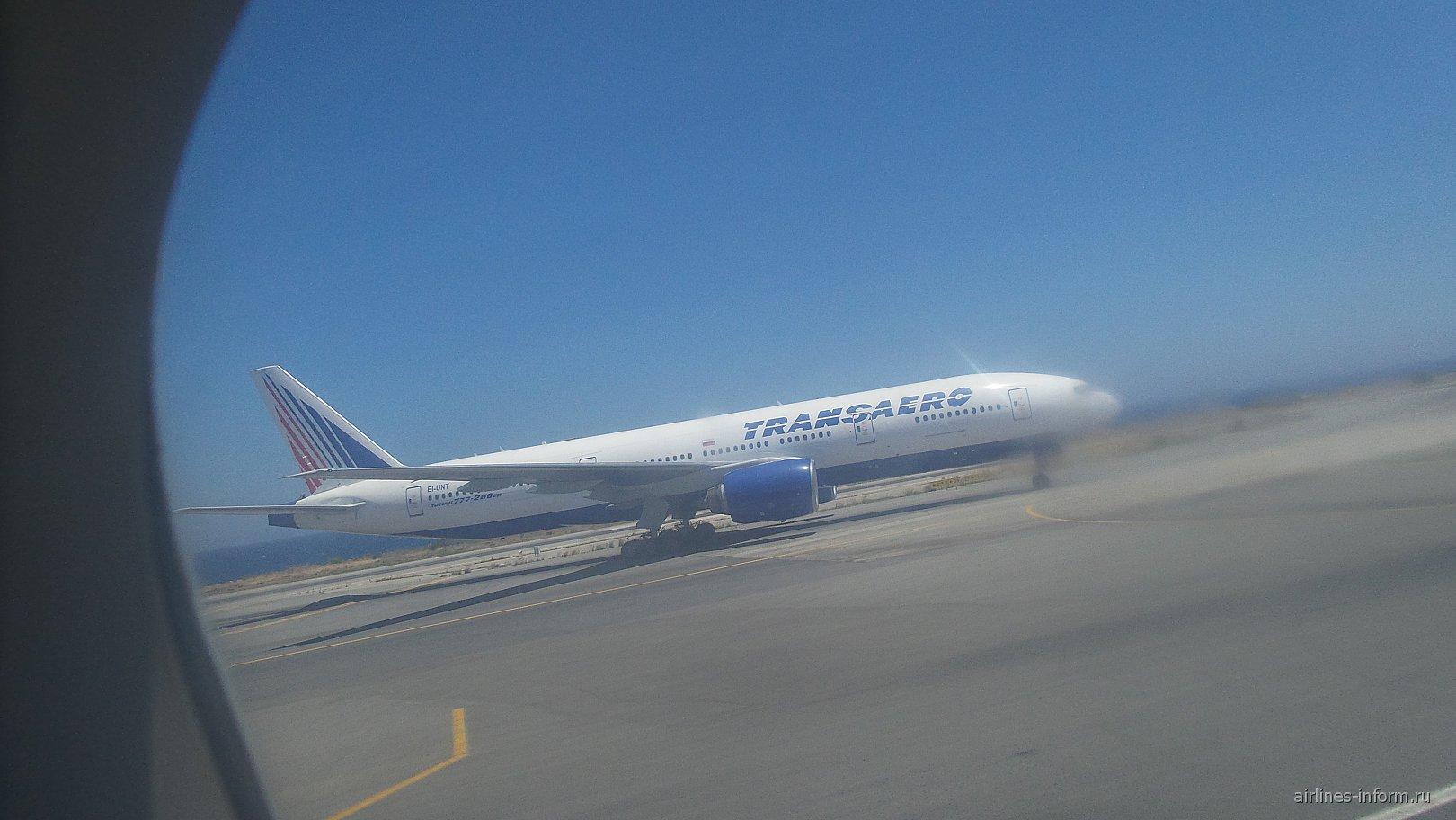 Боинг 777-200 Трансаэро. Бортовой номер EL-UNT.Я уже видел его в чьем-то обзоре.