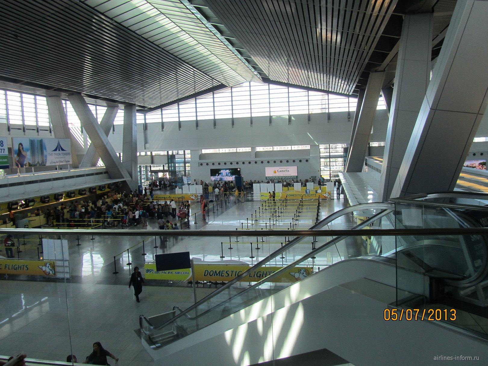 Зал вылета в аэропорту Манила Ниной Акуино