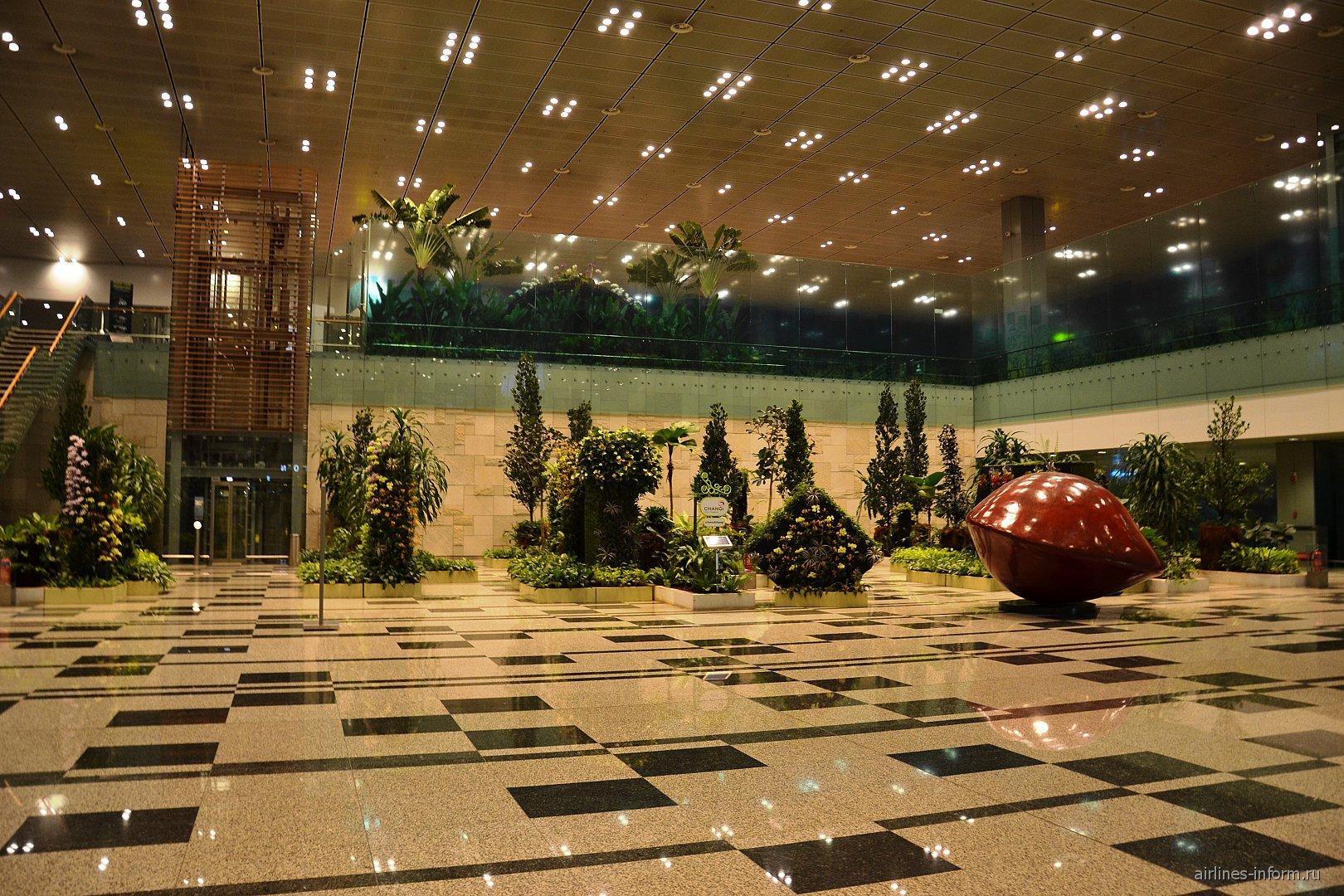Зал прилета в Терминале 3 аэропорта Чанги в Сингапуре