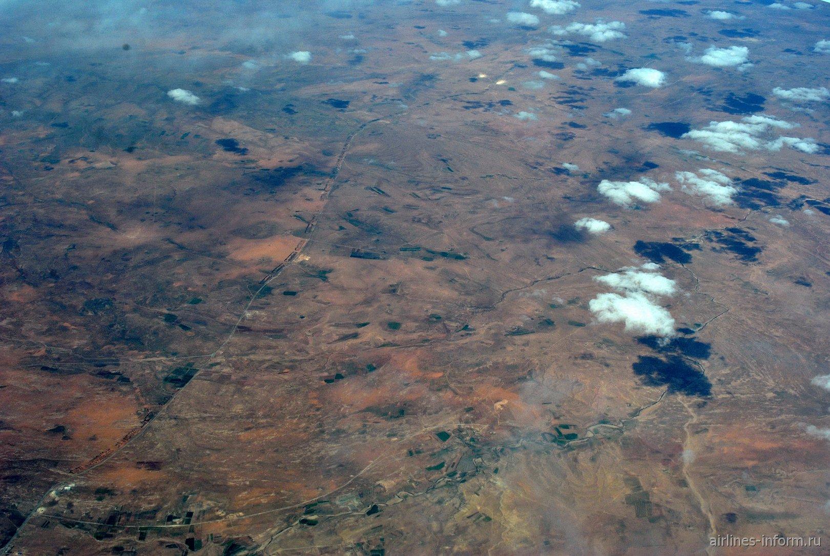 В полете над Алжиром близ города Эль-Баяд