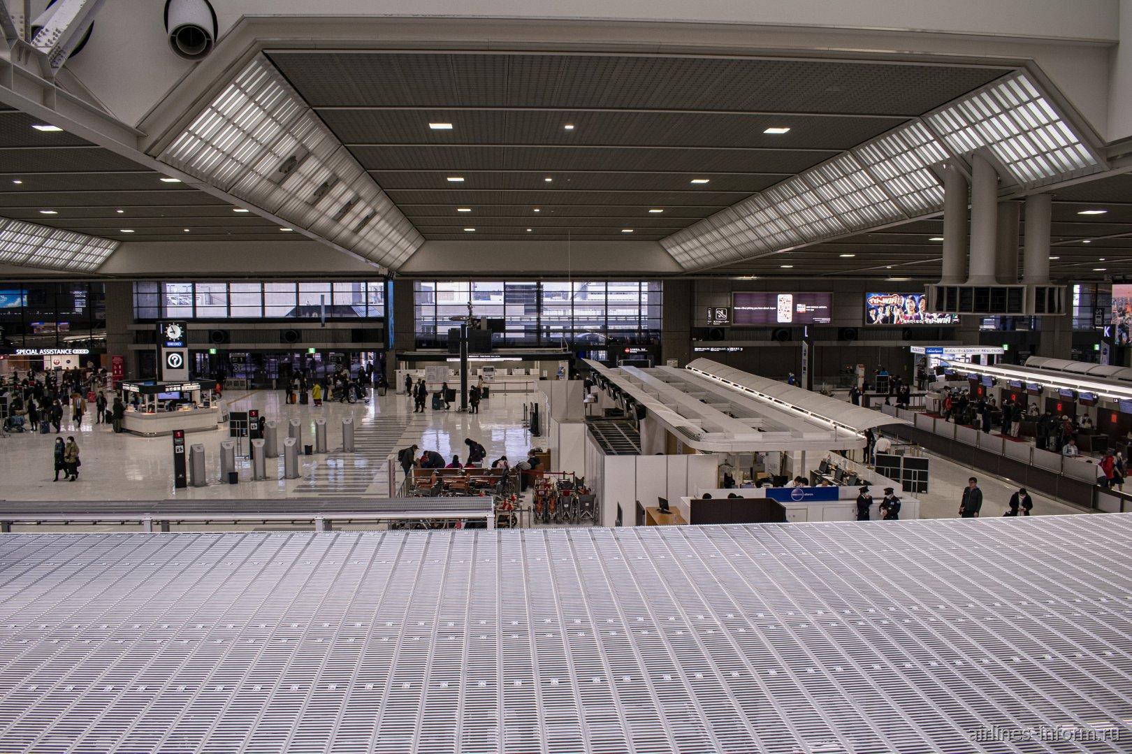 Зал регистрации в терминале 2 аэропорта Токио Нарита
