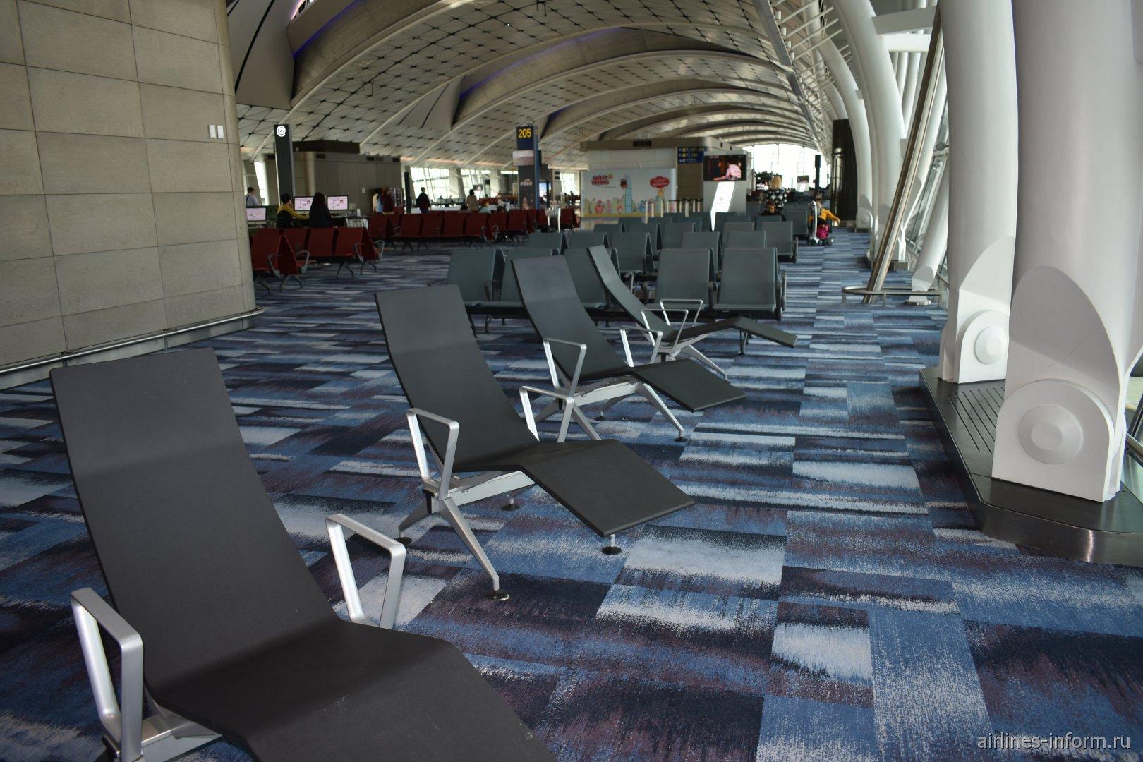 Места для отдыха в Midfield concource аэропорта Гонконг