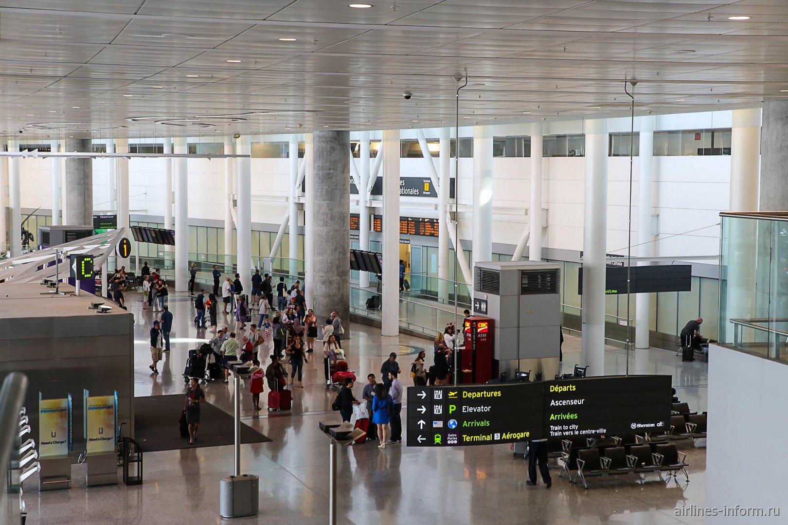 Зона прилета международных рейсов в терминале 1 аэропорта Торонто Пирсон