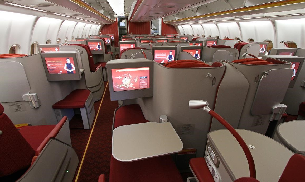 The business class in the A330-300 Hainan Airlines on the route Moscow/Saint Petersburg to Beijing